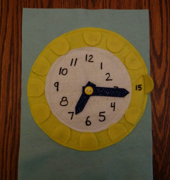"Cloth ""Quiet Book"" Pages, from Holly's latest hand-made children's activity books - Clock page: Tell Time and What do Clock Hands do? activity"